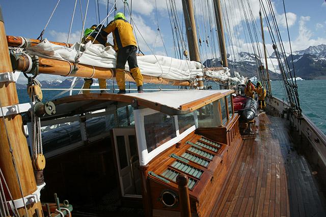Handing sail en route to Cumberland Bay