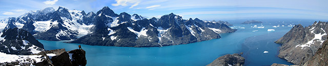 A panoramic view of mountains and icebergs