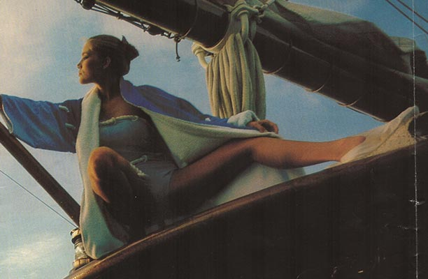 A glamorous model poses for Vogue on Shenandoah's polished decks in the 1980s